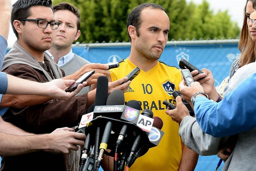 """All-time US scoring leader Landon Donovan (centre) answered questions on Saturday, May 24, 2014, for the first time about his snub from the World Cup squad, saying he """"absolutely deserved"""" to be going to Brazil.- PHOTO: REUTERS"""