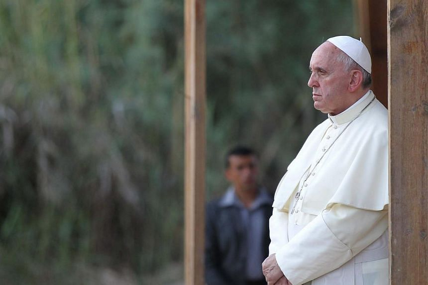 Pope Francis prays in front of the Jordan river in Bethany beyond the Jordan River, the site of Christ's baptism, west of Amman, Jordan, on May 24, 2014. - PHOTO: EPA