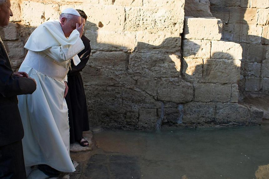 Pope Francis visits Bethany beyond the Jordan river, the site of Christ's baptism, west of Amman, Jordan, on May 24, 2014. - PHOTO: EPA