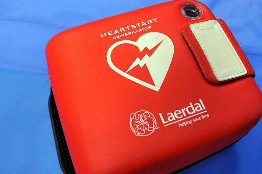 Automated External Defibrillators (AEDs), which are used in the event an individual suffers a heart attack, will be installed in all 107 community centres and clubs in Singapore by the end of the year. -- ST FILE PHOTO