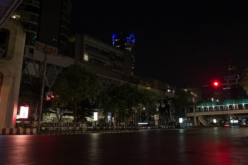 The usually bustling Ratchaprasong intersection during curfew time (10pm to 5am) in Bangkok during the early hours of May 25, 2014. - PHOTO: AFP