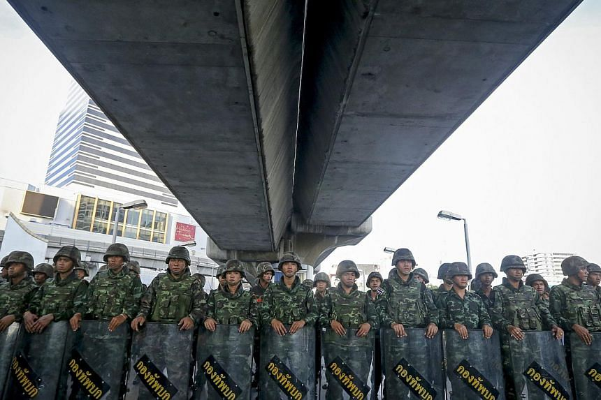 Thai soldiers block access to a section of an overpass during a protest against the military coup in Bangkok, Thailand, on May 24, 2014. - PHOTO: AFP