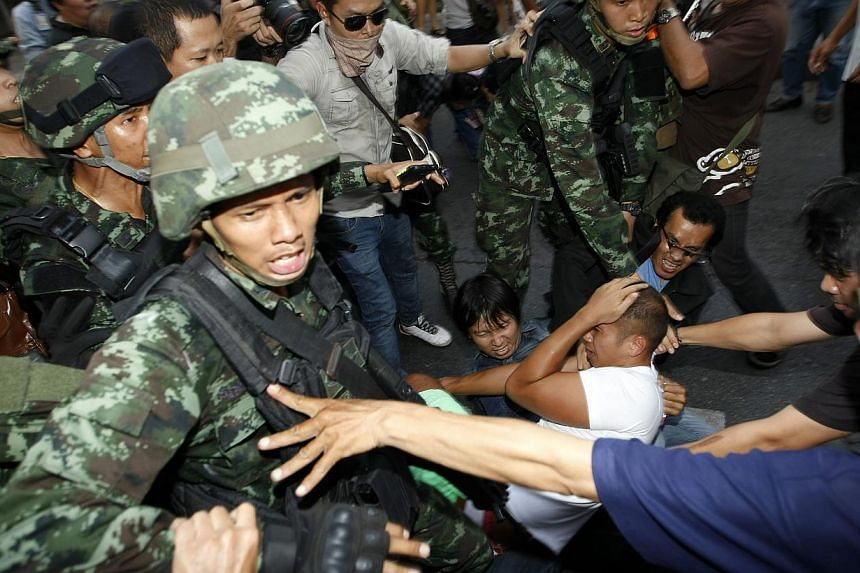 Thai soldiers confronting demonstrators during a protest against the coup near the Victory Monument in Bangkok, Thailand, on May 24, 2014. - PHOTO: EPA