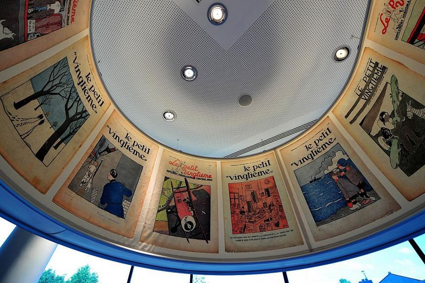 A picture taken on May 22, 2014 shows an inside wiew of the Herge museum in Louvain-La-Neuve. The original page of drawings featuring the intrepid boy reporter Tintin sold at auction on Saturday, May 24, 2014, for more than two million euros, a new w