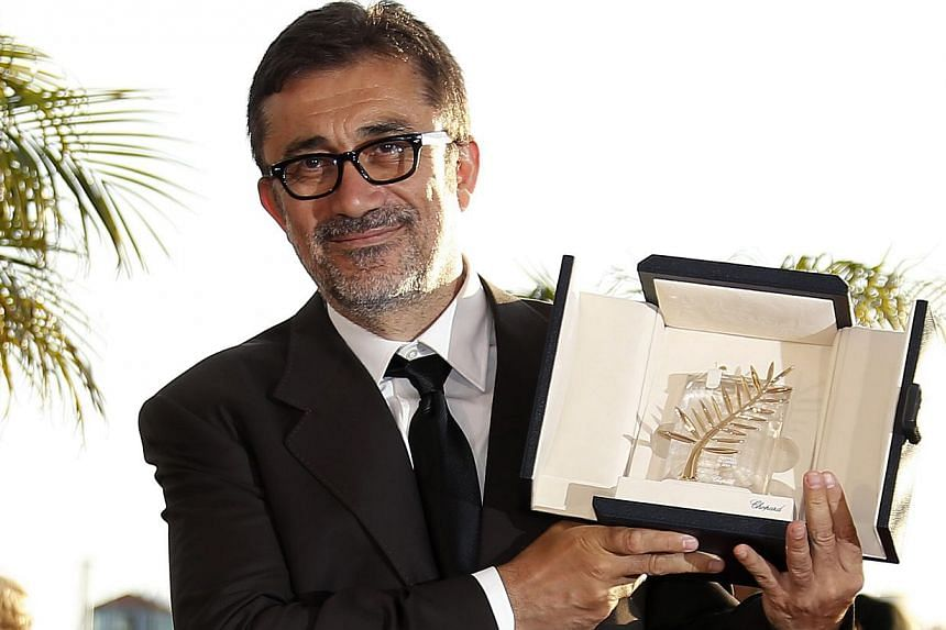 Turkish director Nuri Bilge Ceylan poses during the Award Winners photocall after he won the Palme d'Or (Golden Palm) award for his movie 'Winter Sleep' at the 67th annual Cannes Film Festival in Cannes, France, on May 24, 2014. - PHOTO: EPA