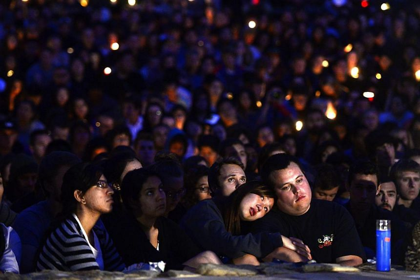 Students gathered for a candlelight vigil on the University of California Santa Barbara campus on May 24, 2014 to remember those killed during a rampage by lone gunman Elliot Rodger in nearby Isla Vista. -- PHOTO: AFP