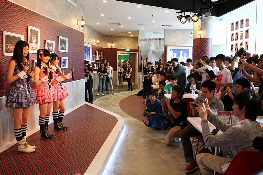 Three members of Japan's top girl group, the 61-member AKB48, graced the launch of the new AKB48 cafe in Singapore on June 25, 2011. -- PHOTO: ASIA PR WERKZ