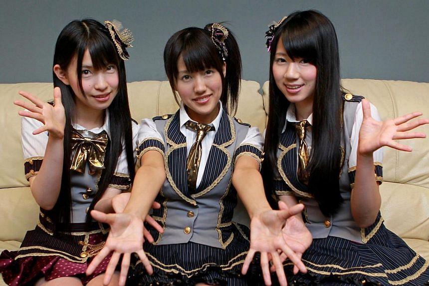 (From left) Rina Matsumoto, Rikaka Hirata and Shiori Takada from Japanese pop girl group SKE48, ham it up for the camera. -- TNP PHOTO: GAVIN FOO
