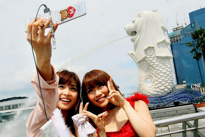 The 12 members of J-pop girl group SDN48 hit Orchard Road to greet fans on June 10, 2011. -- TNP PHOTO: KELVIN CHNG