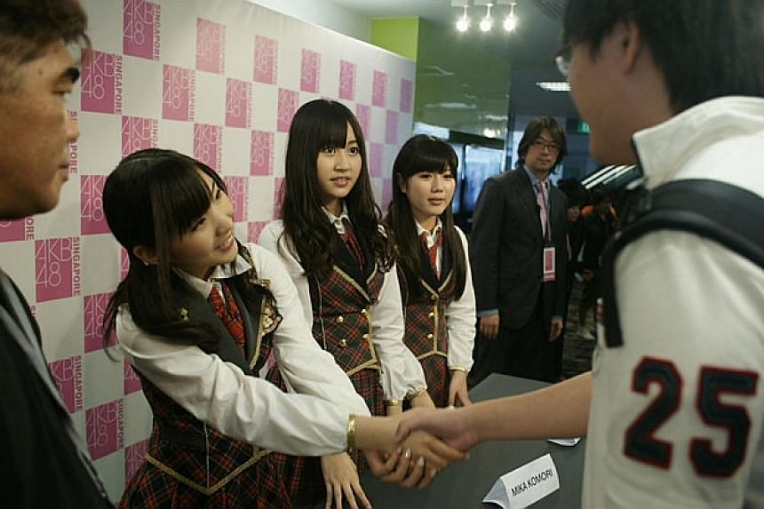 (From left) Japanese pop group AKB48's Misaki Iwasa, Mika Komori and Miho Miyazaki met fans on May 14, 2011, and also performed at *Scape on the next day. -- PHOTO: AKB48 Singapore
