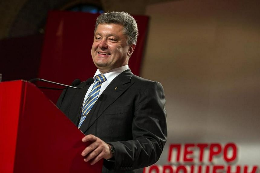 Ukrainian businessman and Presidential candidate Petro Poroshenko speaks during his press conference in his election headquarters in Kiev, Ukraine on May 25, 2014. Ukraine's next president, Petro Poroshenko, said on Monday, May 26, 2014, he hope