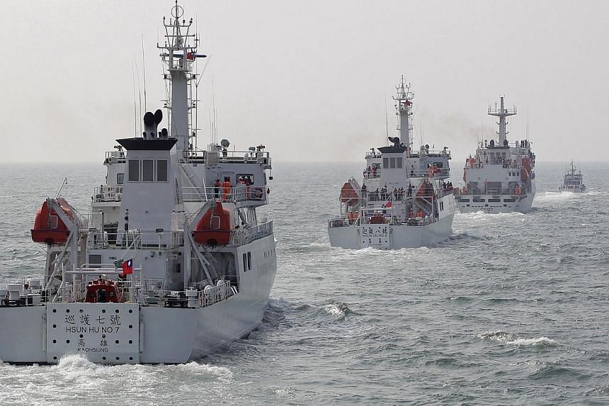 Taiwan Coast Guard patrol ships are seen during a drill held about 30 nautical miles northwest of the port of Kaohsiung, southern Taiwan, on March 30, 2013. Taiwan is building a US$100 million (S$125.3 million) port next to an airstrip on the lone is