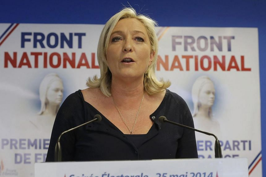Marine Le Pen, France's National Front political party head, reacts to results after the polls closed in the European Parliament elections at the party's headquarters in Nanterre, near Paris on May 25, 2014. -- PHOTO: REUTERS
