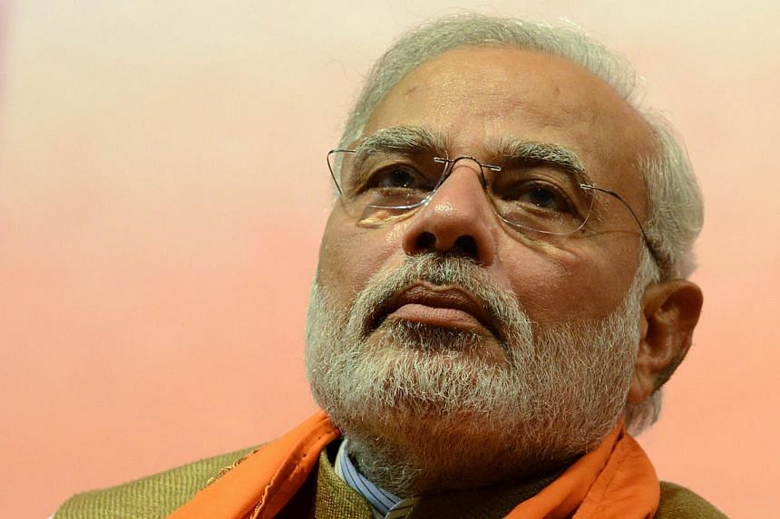 Indian Prime Minister-Elect, Narendra Modi gestures during the announcement of Gujarat's first woman chief minister, Anandiben Patel during a meeting at the Town Hall in Gandhinagar, some 30km from Ahmedabad on May 21, 2014. Hindu nationalist Narendr