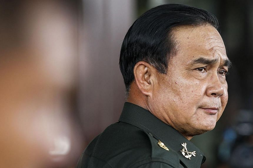 Thai Army chief General Prayuth Chan-ocha arrives before a meeting with high ranking officials at the Army Club after the army declared martial law nationwide to restore order, in Bangkok May 20, 2014. -- FILE PHOTO: REUTERS