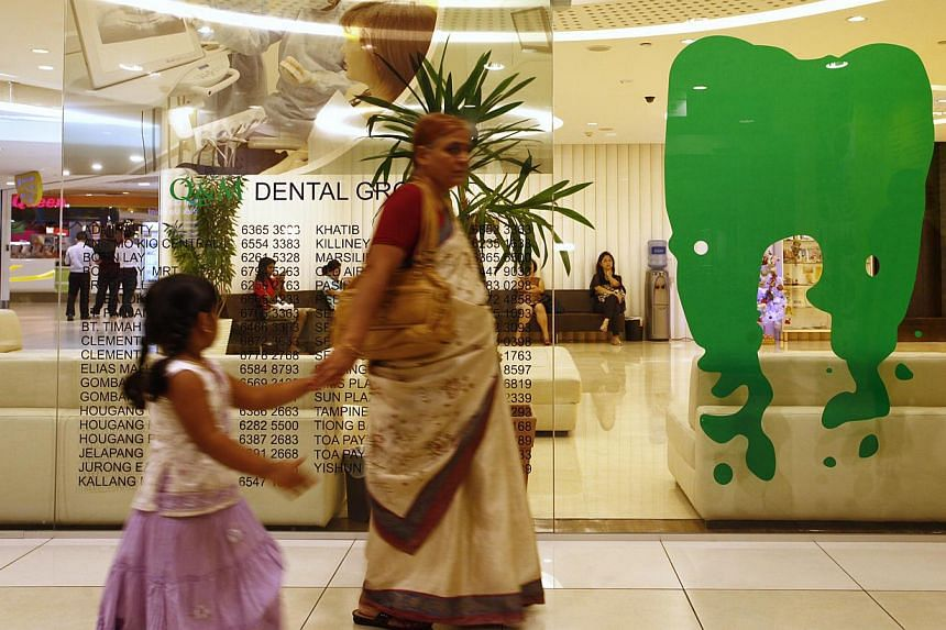 Q&M dental clinic located in the City Square Mall on Dec 27, 2012. Q&M Dental Group said on Monday it has formed a strategic partnership with Singapore-headquartered conglomerate IMC Group. -- FILE PHOTO: ST