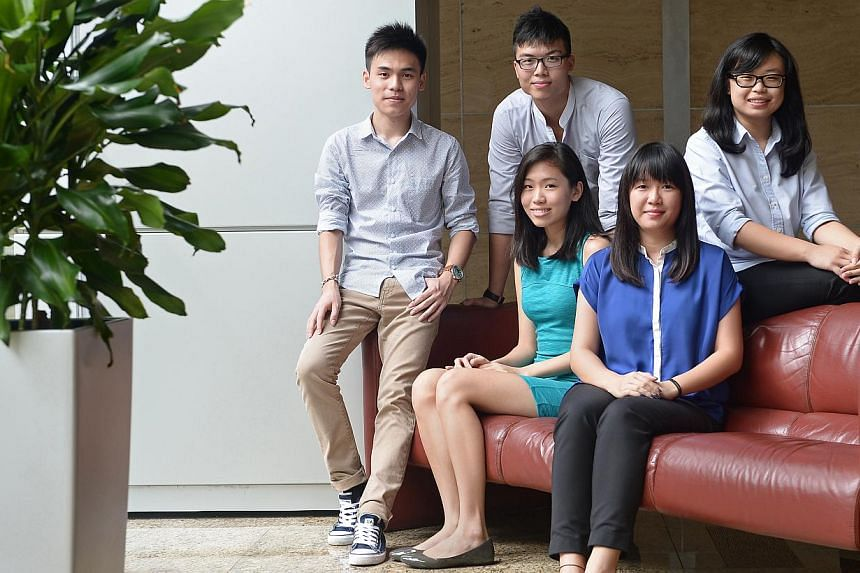 (Seated, from left) Singapore Polytechnic (SP) graduate Janna Wong, 21, and Temasek Poly (TP) graduate Samantha Lek, 20, will be studying law at NUS, while (back row, from left) SP graduate Raphael Ng, TP graduate Joshua Teo and Ngee Ann Polytechnic