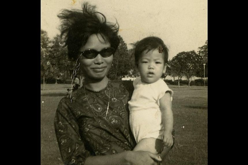 Fashion stylist Jeanette Ejlersen with her mother Yam Soh Lui (left) at age one, and with her stepfather Karl Aage Ejlersen when she was 10 or 11 years old (above). Ejlersen (with Mavis Ee, who later became a national swimmer) during her secondary sc