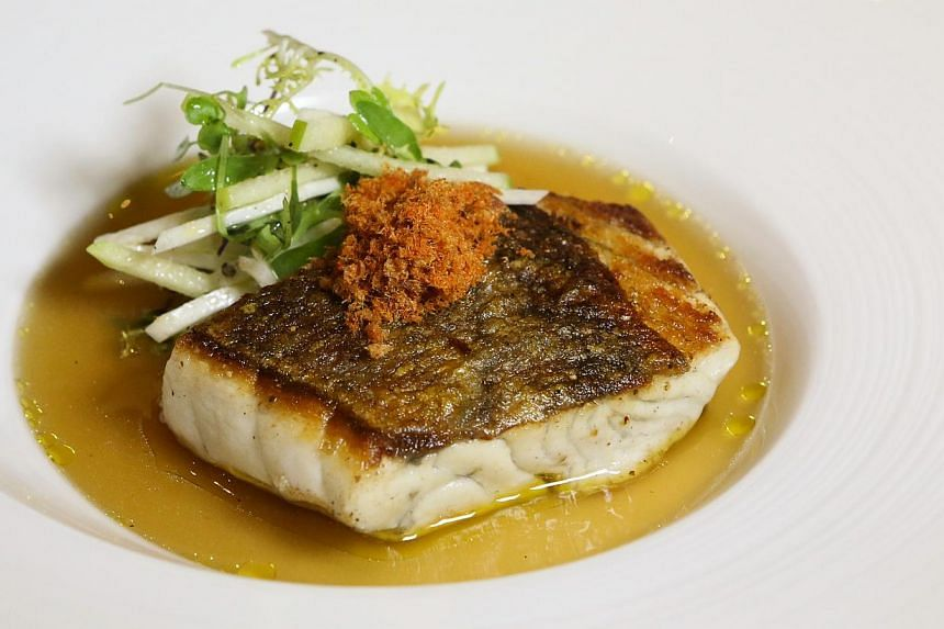 Crispy Skin Barramundi- Parma Ham Floss & Olive Oil Mashed Potato (above) and Cremet D'anjou – Cheese Curd & Fresh Berries are some of the dishes featured at celebrity cook Cat Cora's restaurant here. -- PHOTO: RESORTS WORLD SENTOSA