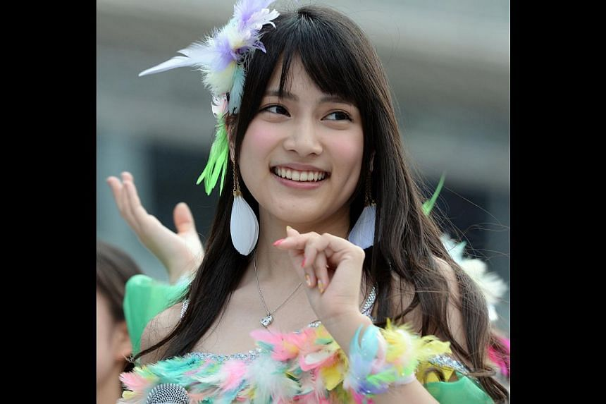 This picture taken on June 8, 2013 shows Japanese girls' pop group AKB48 member Anna Iriyama during the group's concert at the Yokohama stadium. Iriyama and her teammate, Rina Kawaei as well as one male staff had their hands slashed by a 24-year-old