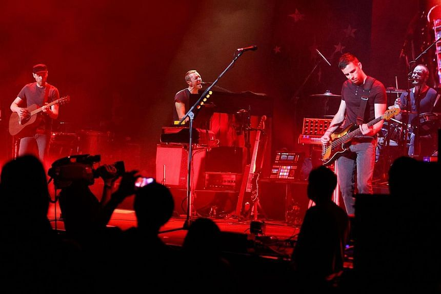 Musicians (from left) Jonny Buckland, Chris Martin, Guy Berryman, and Will Champion of Coldplay perform onstage at Royce Hall, UCLA on May 19, 2014 in Westwood, California. Coldplay's new album Ghost Stories went straight to number one in the ch