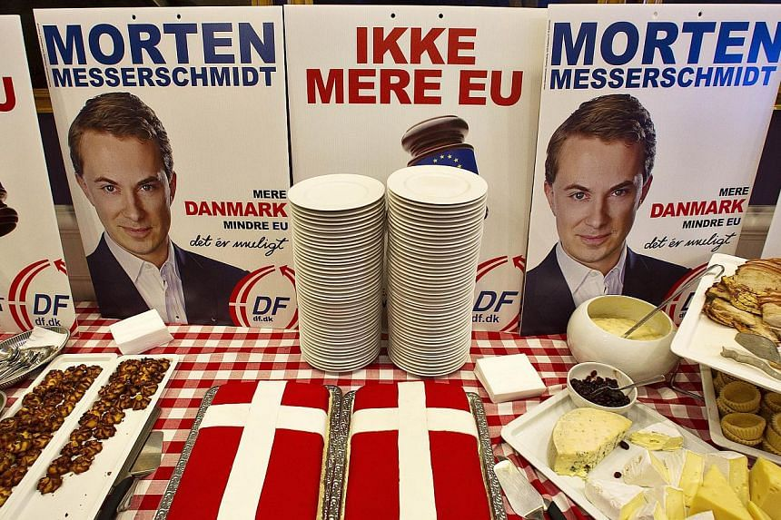 A poster featuring Danish People's Party's leading candidate for the European elections Morten Messerschmidt and reading 'No more EU' is displayed at the Danish Parliament in Copenhagen on May 25, 2014 after the European Parliament election. Messersc