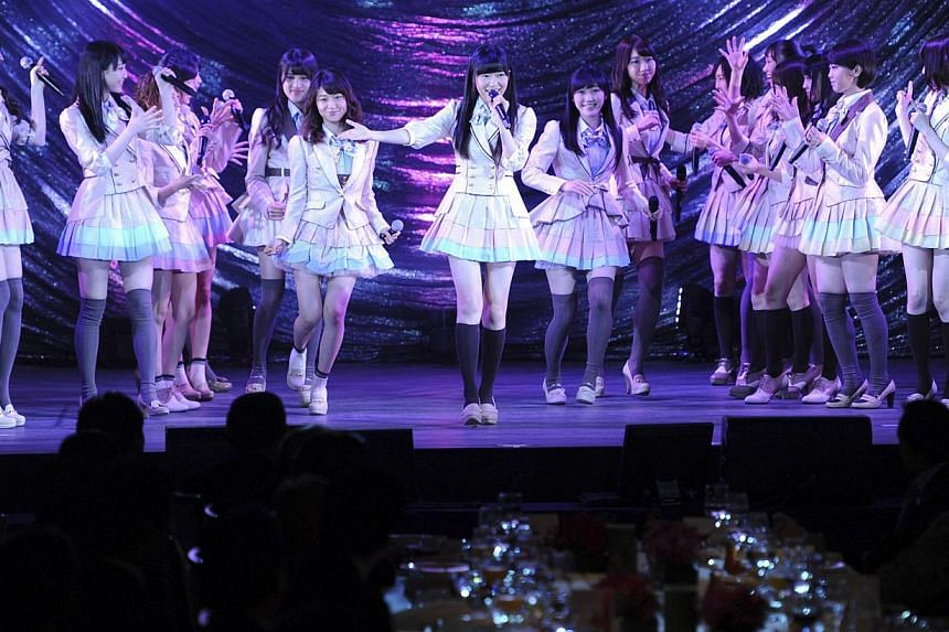 Japanese girls' pop group AKB48, led by Rino Sashihara (centre), performs on the stage during a gala dinner of the Asean-Japan Commemorative Summit meeting hosted by Japan's Shinzo Abe (not in picture), in Tokyo Dec 14, 2013 file photo. Two members o