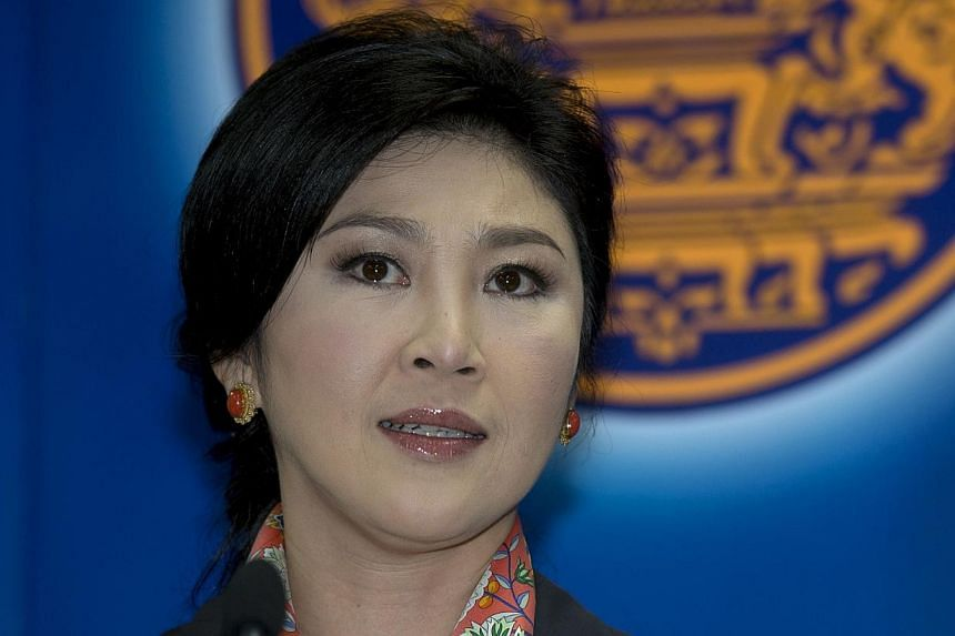 Thai Prime Minister Yingluck Shinawatra answers questions from the media during a press conference at the permanent secretary for defence suburb of Bangkok on May 7, 2014. The Thai militaryrelaxed restrictions on MsYingluck, allowing her