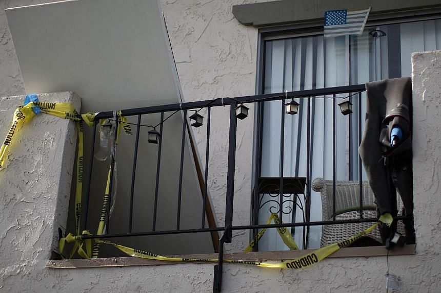 Crime scene tape hangs from an apartment balcony at a shooting site on Del Playa Drive on May 25, 2014 in Isla Vista, California. -- PHOTO: AFP