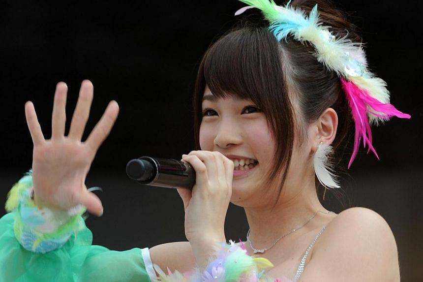 This picture taken on June 8, 2013 shows Japanese girls' pop group AKB48 member Rina Kawaei during the group's concert at the Yokohama stadium. Kawaei and her teammate, Anna Iriyama as well as one male staff had their hands slashed by a 24-year-old m
