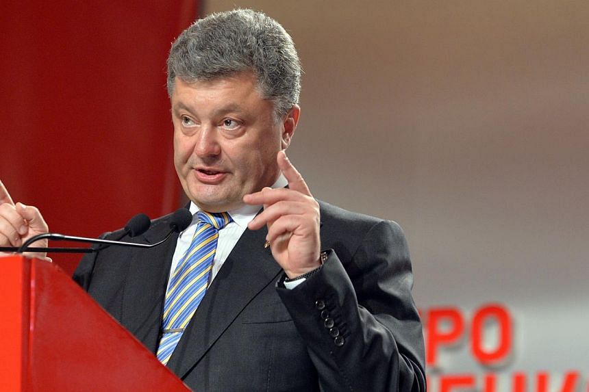 Presidential candidate Petro Poroshenko gives a press conference in Kiev after exit polls were announced on May 25, 2014. -- PHOTO: AFP