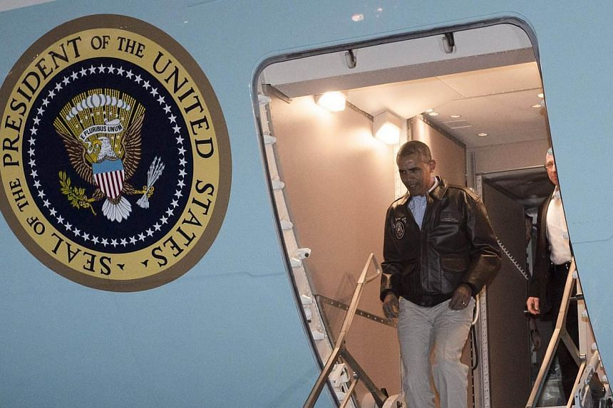 US President Barack Obama disembarks from Air Force One upon arrival at Bagram Air Field, north of Kabul, in Afghanistan on May 25, 2014, as he made a surprise trip to visit US troops prior to the Memorial Day holiday. -- PHOTO: AFP