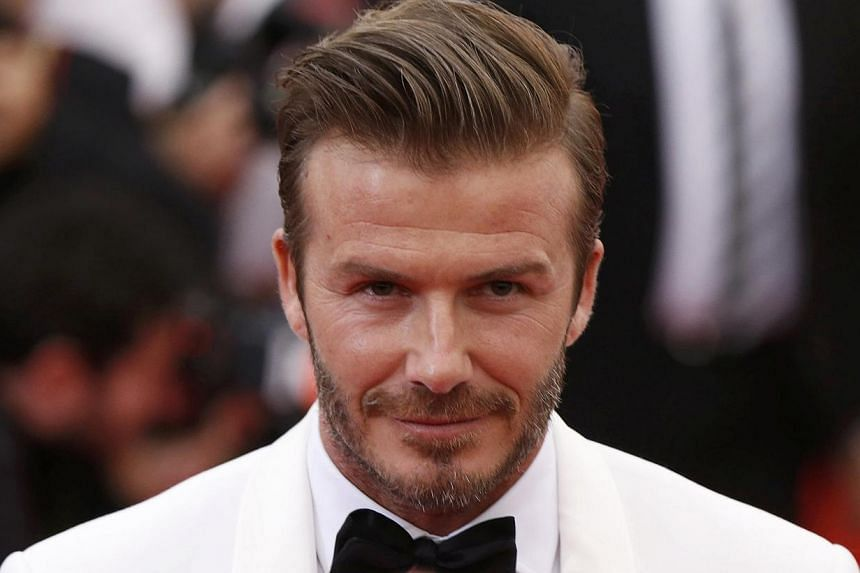 Football star David Beckham will be arriving in Singapore next month as part of a Marina Bay Sands (MBS) initiative to reward its Facebook followers from Singapore, Malaysia, Indonesia, Korea and China. -- PHOTO: REUTERS