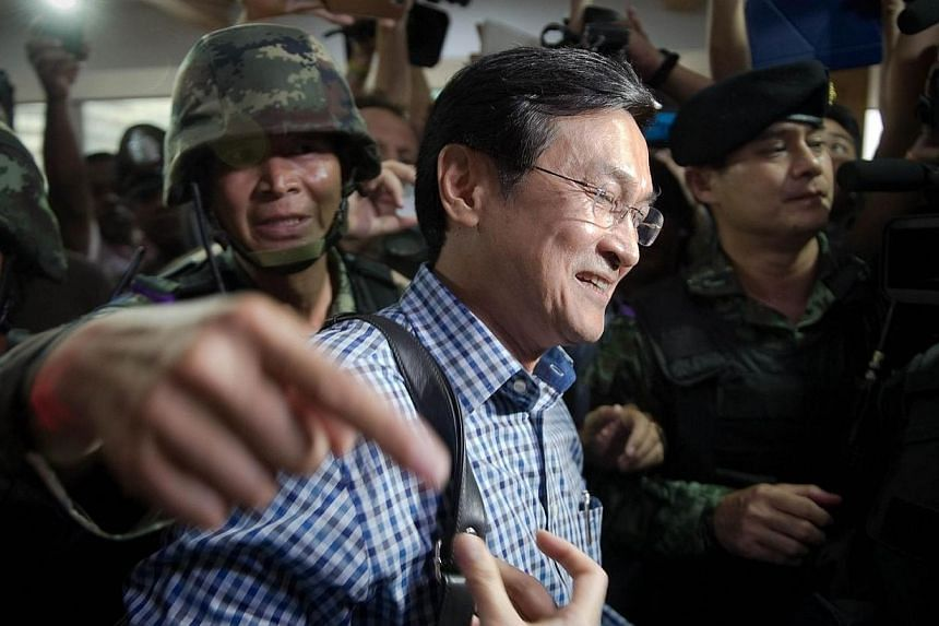 Chaturon Chaisang, former education minister in the government ousted by the military last week is arrested by Thai soldiers at the FCCT (Foreign Corespondent Club in Thailand) in Bangkok on May 27, 2014. -- PHOTO: AFP