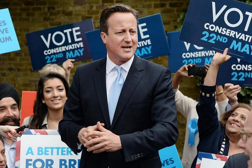 """British Prime Minister David Cameron (centre) holds an election rally ahead of European elections in Ealing, west London, on May 21, 2014.Mr Cameron will launch an assault against """"business as usual"""" at a summit in Brussels on Tuesday, May 26,"""