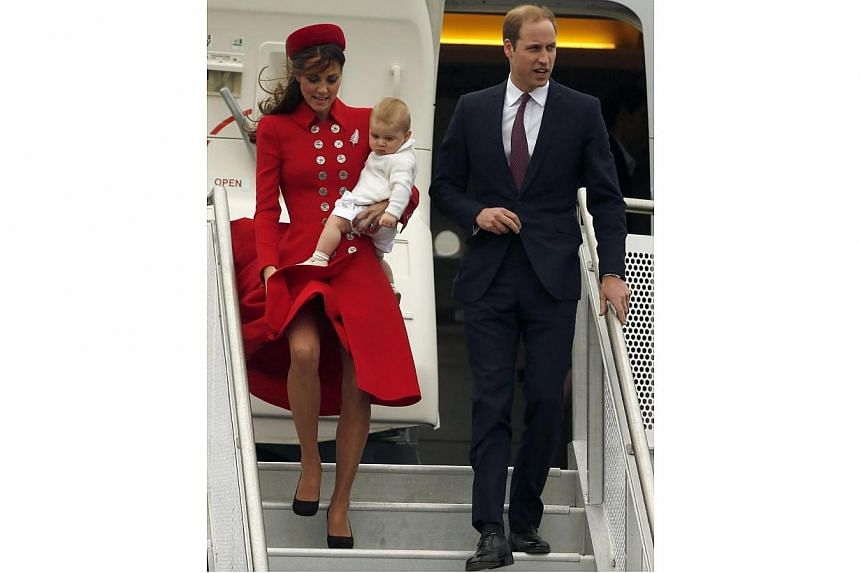Britain's Prince William, his wife Catherine, Duchess of Cambridge and their son Prince George disembark from their plane after arriving in Wellington on April 7, 2014. The Duchess of Cambridge has suffered a couple of embarassing wardrobe malfu