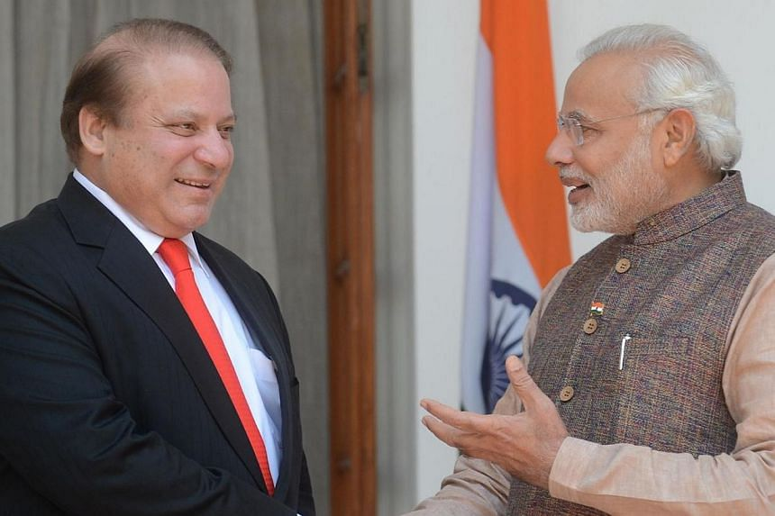 India's newly sworn-in Prime Minister Narendra Modi (right) talks with Pakistani Prime Minister Nawaz Sharif as they shake hands during a meeting in New Delhi on May 27, 2014. Mr Modi told Mr Sharif that Pakistan must prevent militants from using its