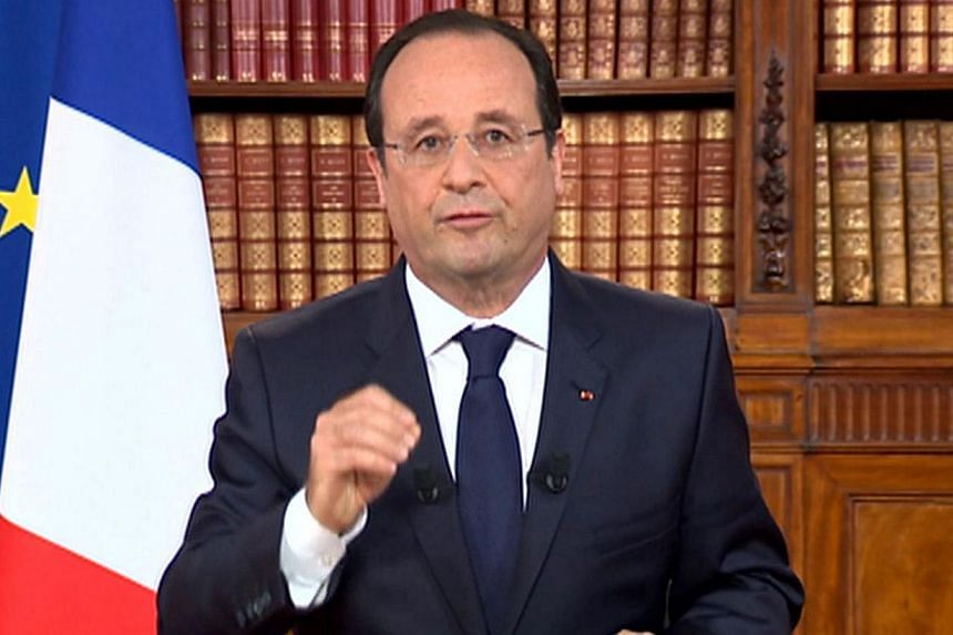 A TV grab taken from French TV channel France 2 shows French President Francois Hollande addressing the nation, on May 26, 2014 during a TV broadcoast at the Elysee presidential Palace in Paris. -- PHOTO: AFP