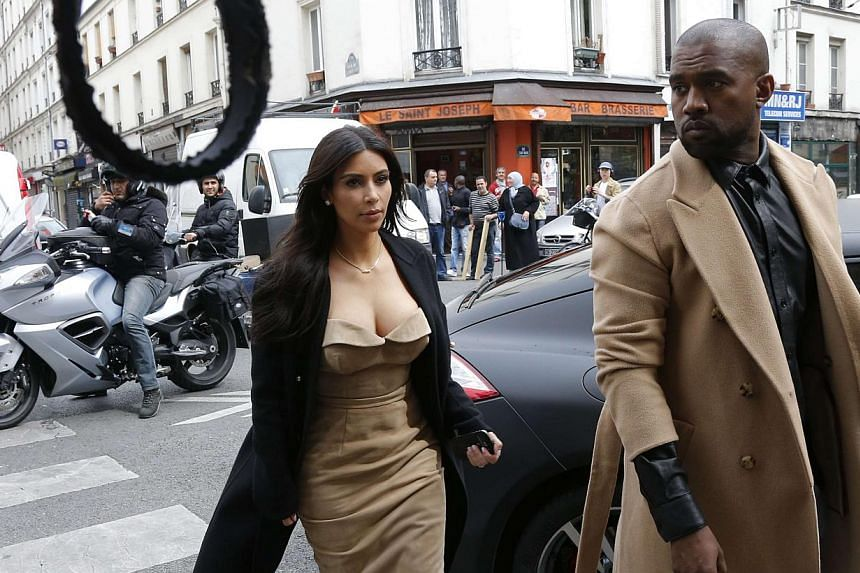 TV personality Kim Kardashian (left) and rapper Kanye West arrive at a fashion designer workshop in Paris on May 21, 2014. -- PHOTO: REUTERS