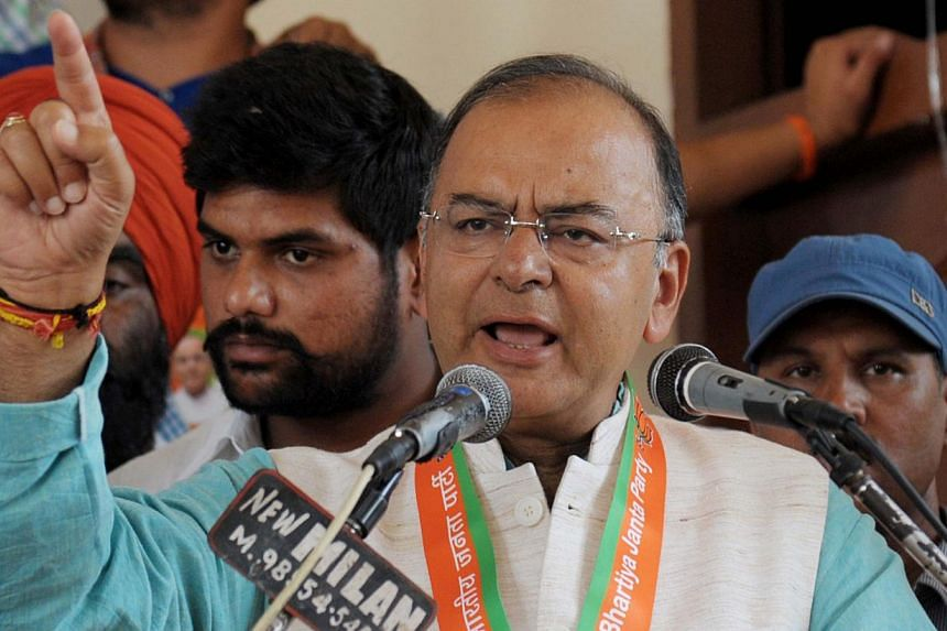 India's new finance minister Arun Jaitley said restoring growth and containing inflation are the key challenges facing the country's government, shortly after being handed the critical portfolio on Tuesday. -- PHOTO: AFP