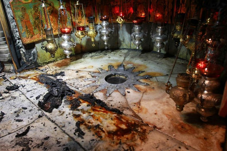 The Grotto, at the Church of the Nativity, believed to be the birthplace of Jesus Christ, is seen on May 27, 2014, after fire broke out just hours after Pope Francis wrapped up a three-day Middle East pilgrimage which saw him visit the shrine. A