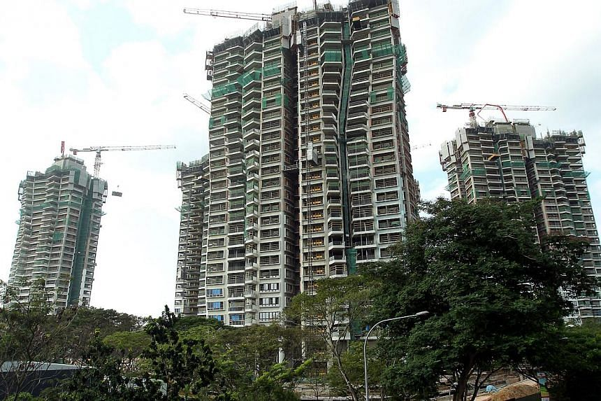 The National Environment Agency (NEA) issued four stop work orders at the D'Leedon (above) and Leedon Residence condominium projects in the Holland area between April 10 and May 15. -- PHOTO: ST FILE