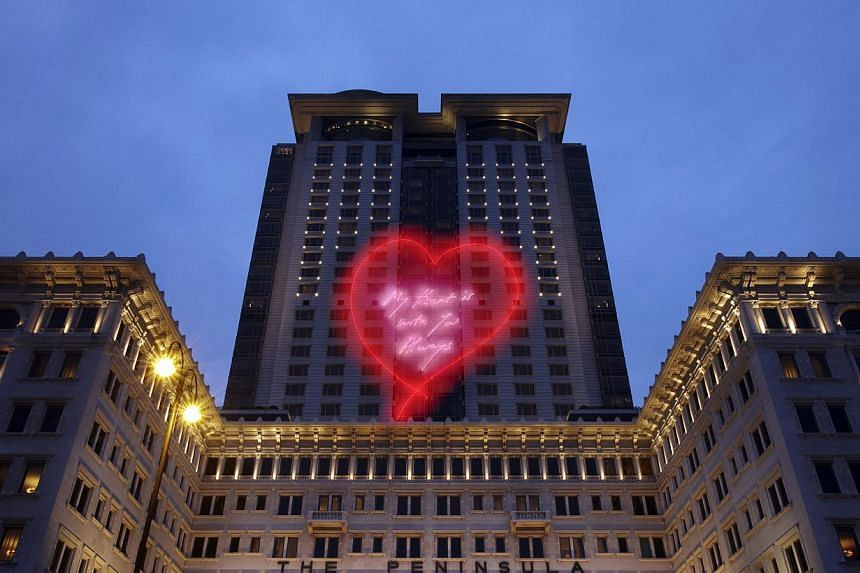 Interactive art installation Ping Pong Go-Round by Singapore artist Lee Wen was shown at the recent Art Basel in Hong Kong, while Tracey Emin's My Heart Is With You Always was displayed on the facade of The Peninsula hotel (above) in Hong Kong ever