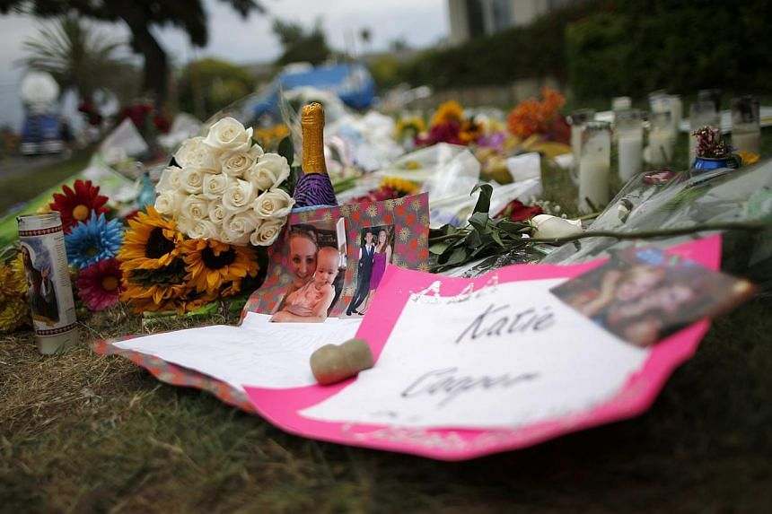 A makeshift memorial is seen in front of the Alpha Phi sorority house where two women were killed in the Isla Vista neighborhood of Santa Barbara, California on May 26, 2014. -- PHOTO: REUTERS