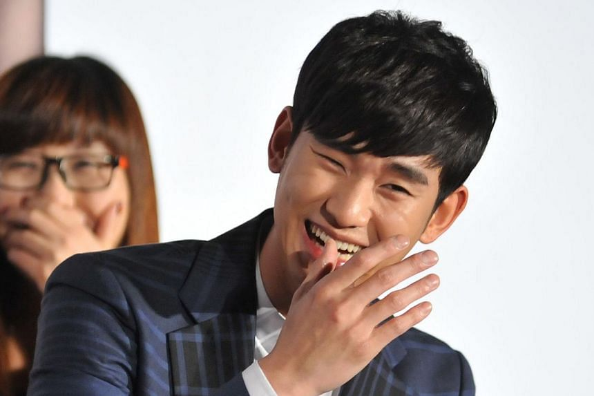 South Korean actor Kim Soo-Hyun attends his 1st Memories In Taiwan press conference in Taipei on March 21, 2014. In an apparent show of support for Kim, a fan alleged to be a rich Chinese woman ran a full-page ad for the heartthrob in the May 26 edit