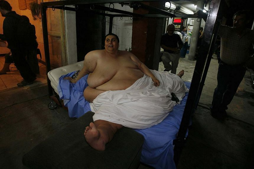 Mexican Manuel Uribe, then with 40 years old and weighing 597 kilograms, in Monterrey, Mexico on Jan 17, 2006. Uribe died on 26 May 2014,-- PHOTO: REUTERS