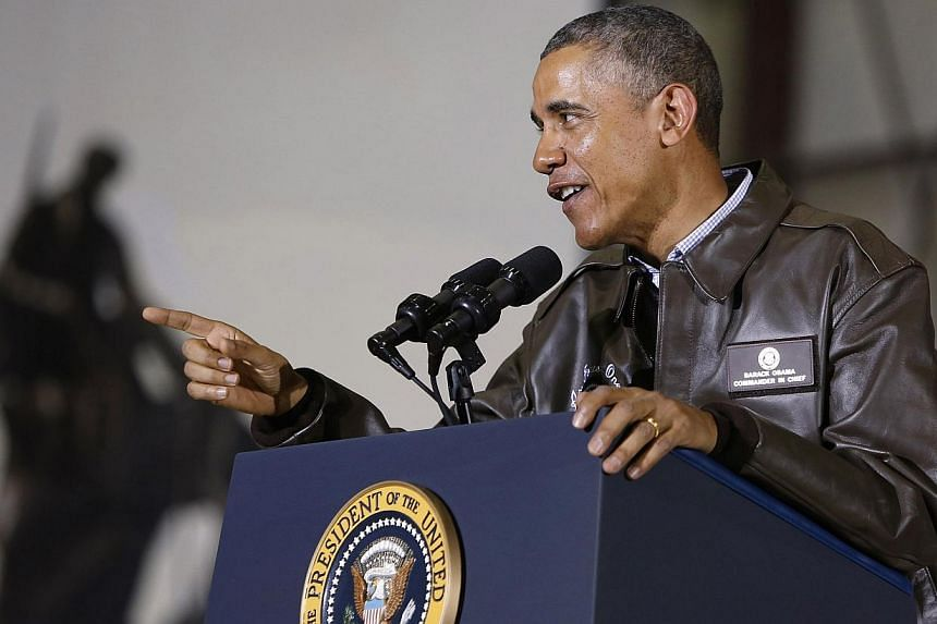 United States (US) President Barack Obama tells US troops based in Afghanistan that he'll shake hands with each of them at the end of his remarks, at Bagram Air Base in Kabul on May 25, 2014. -- PHOTO: REUTERS