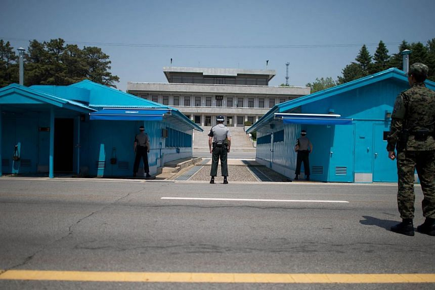South Korean soldiers face the North korean side of the truce village of Panmunjom in the Demilitarized Zone (DMZ) between North and South Korea on May 14, 2014. --  FILE PHOTO: AFP