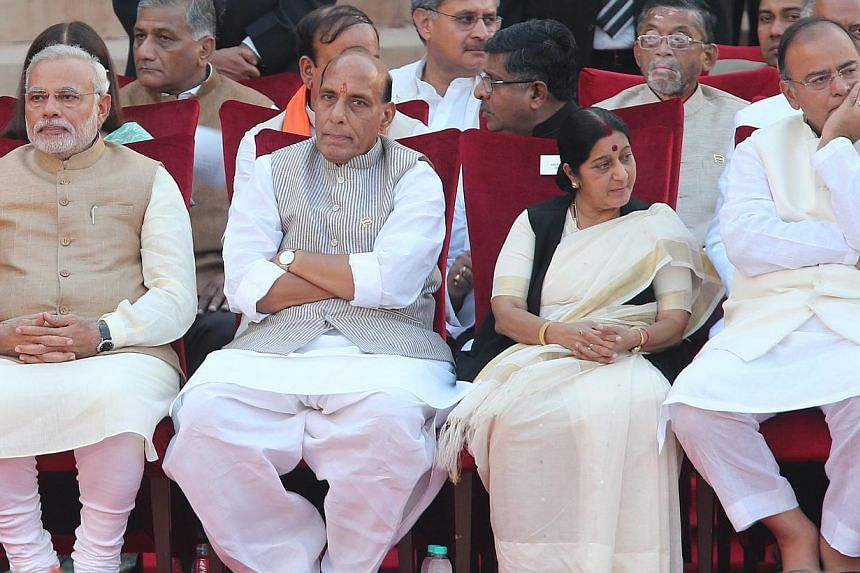 (From left) New Indian Prime Minister Narendra Modi with his new Cabinet Ministers Rajnath Singh, Sushma Swaraj and Arun Jaitley during swearing-in ceremony of Narendra Modi as the new Prime Minister of India at the presidential palace in New Delhi,
