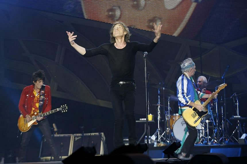 Mick Jagger (second left), front man of the British rock band the Rolling Stones, performs on stage with fellow band members Ronnie Wood (left) on guitar, Charlie Watts (right) on drums and Keith Richards (second right) on guitar during a concert in